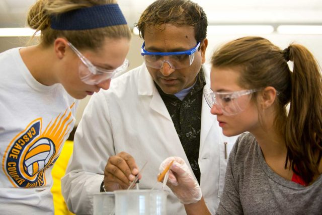 Clarke chemistry major students experimenting in class.