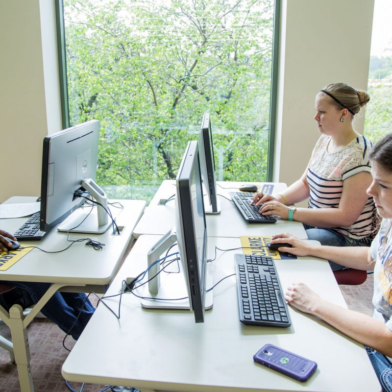 Clarke student working on her Communication Degree project in a computer lab
