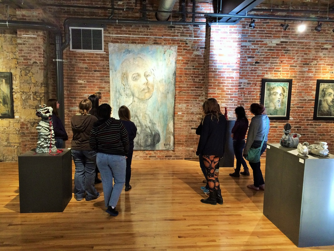 Students in Art Education Major at Clarke University attending local gallery opening.