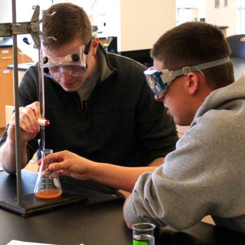 Two chemistry degree program students at Clarke University