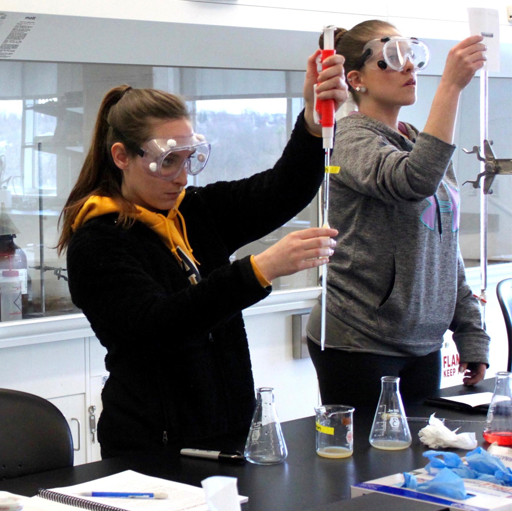 Clarke University Biochemistry students working in lab.