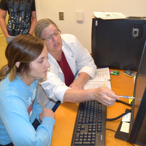 Biochemistry Degree student getting instruction from Clarke University Professor
