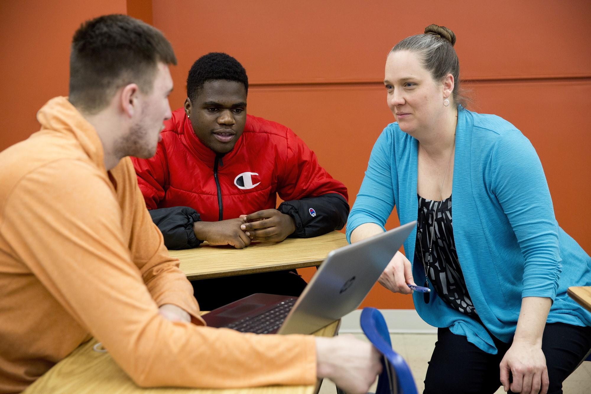 Clarke University Students learning in class.