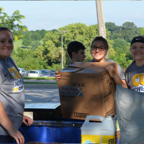 Clarke students helping with the move in process