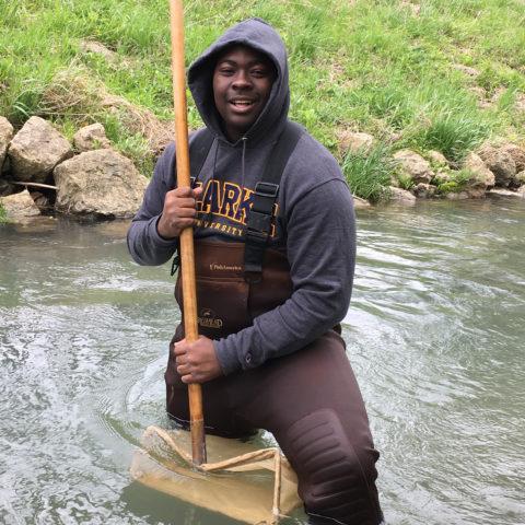 Clarke University Environmental Studies program student at work in a local river.