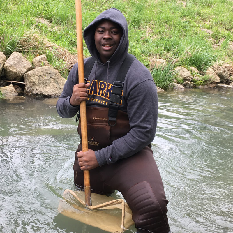 Clarke University Environmental Studies program student at work in a local river.