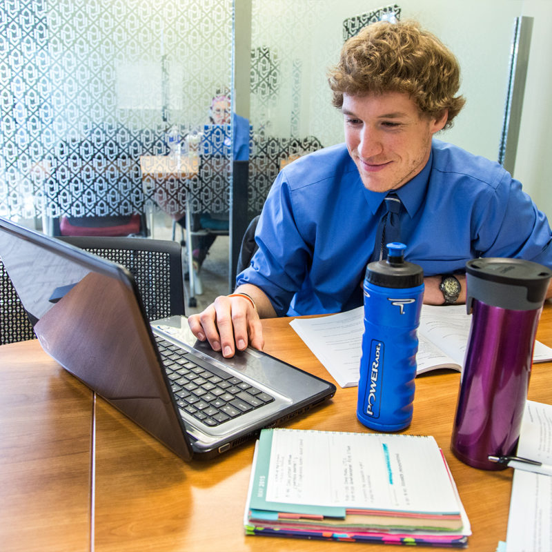 Clarke University Accounting Degree student studying in the library