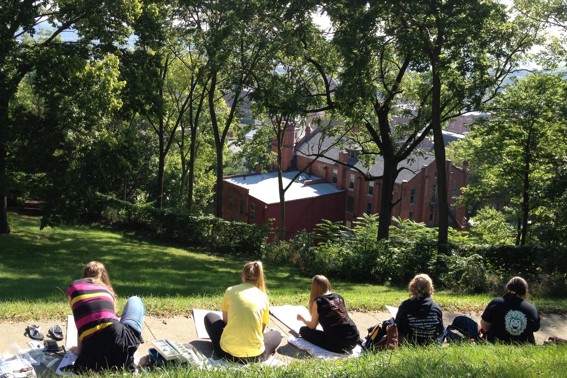 Clarke University students attending outdoor class.