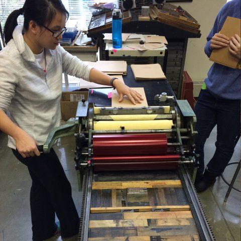 Students work on press printers