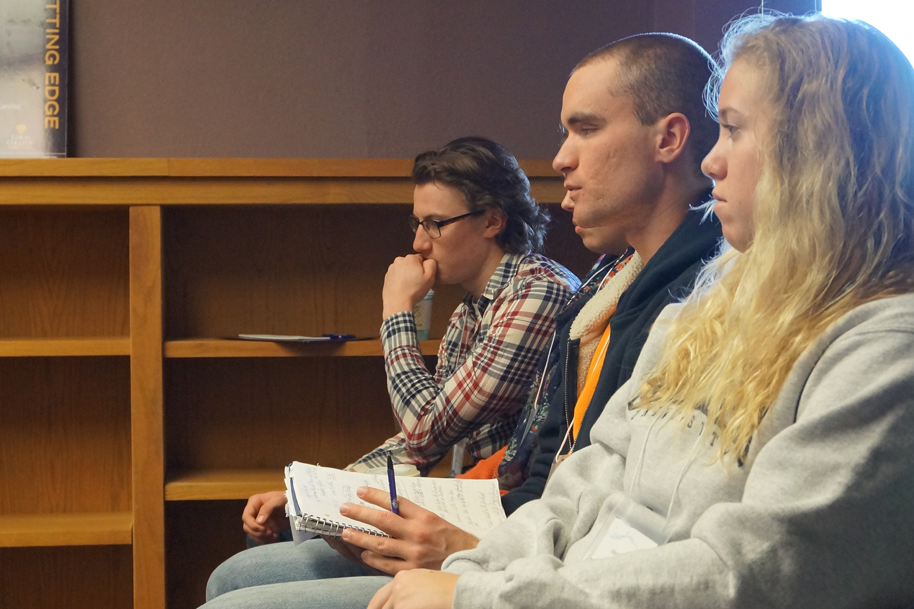 English students in class listening to a lecture at Clarke University.