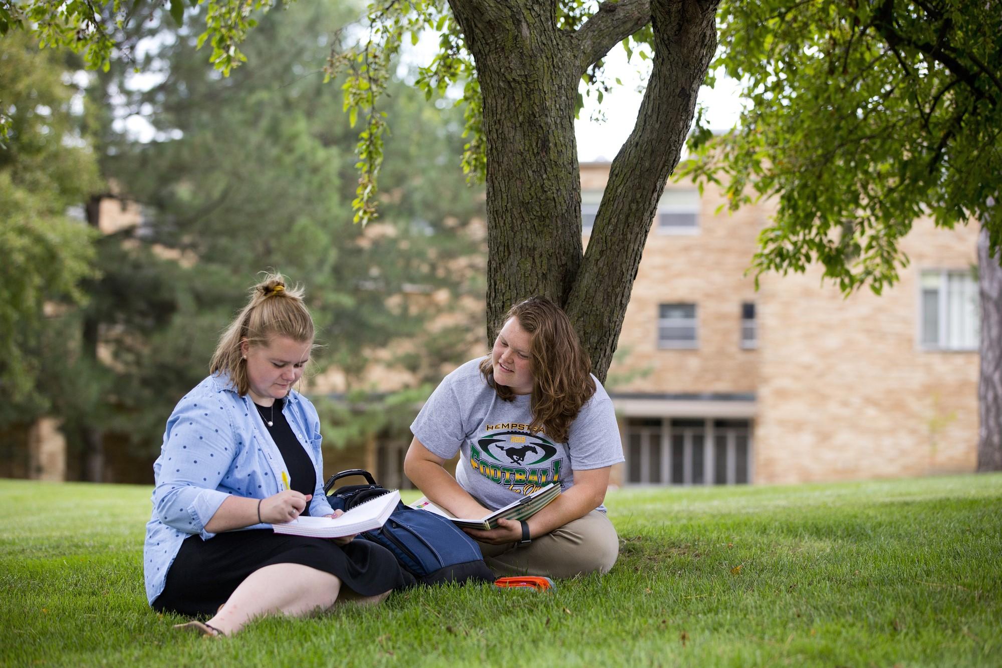 Clarke University Senior Philosophy Major students studying on Clarke's campus.