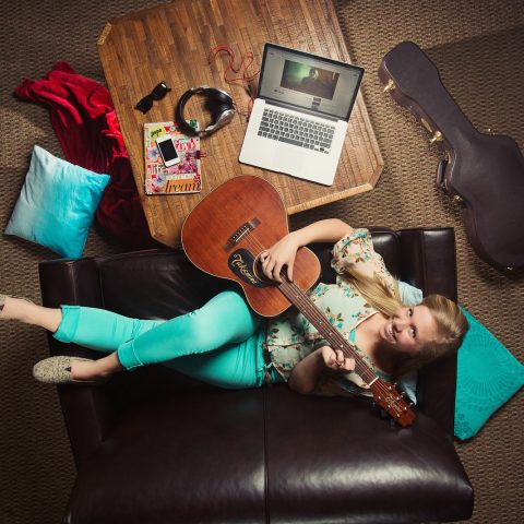 Overhead photo of Clarke Music Degree Student with a guitar