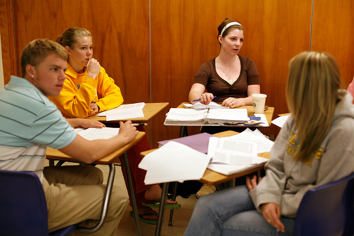 Clarke University students in class working on a project.
