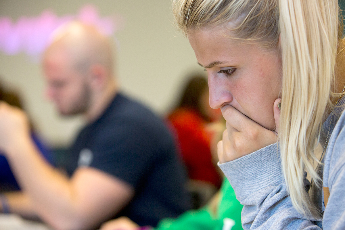 Clarke University students in a class researching during lecture.