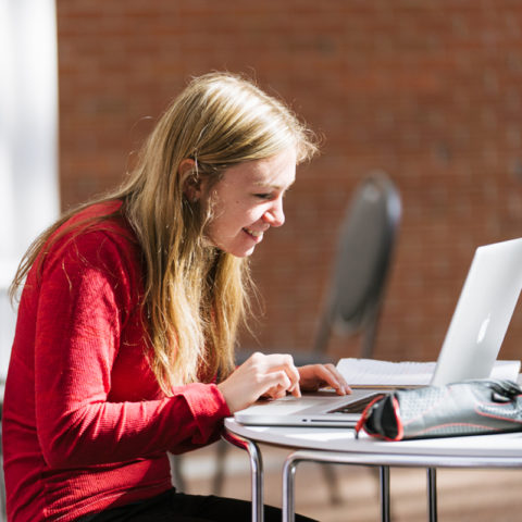 Clarke University Communications Major Student Studying